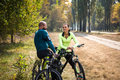 Couple of cyclists resting in park Royalty Free Stock Photo
