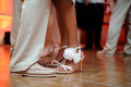 Couple dancing on dance floor a at a wedding receptions the legs and feet only faces not shown Stock Photos
