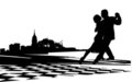 Couple dancing the tango on the chess floor Royalty Free Stock Image