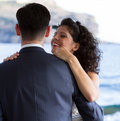 Couple dancing the wedding dance first with crystal blue sea on background Stock Photo