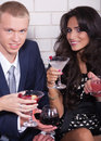Couple on date in bar or night club enjoying wine Stock Photography