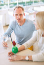 Couple dating moment in cozy sunny restaurant Royalty Free Stock Image