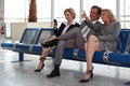 Couple in departure lounge. Royalty Free Stock Photo