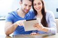 Couple with digital tablet young using Stock Photography