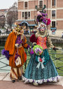 Couple disguised annecy france march a poses near a water canal during the annecy venetian carnival yearly in annecy france is Stock Images