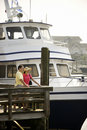 Couple at dock. Stock Photography