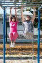 Couple Doing Exercise With Dips Bar in Park Royalty Free Stock Photo