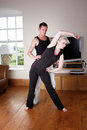 Couple doing exercise a in the living room Stock Photo