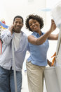 Couple Doing Household Chores Stock Photo