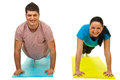 Couple doing push-ups Royalty Free Stock Images
