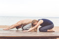 Couple are doing stretching at sea coast Royalty Free Stock Photo