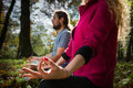 Couple doing yoga meditation Stock Photo