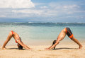 Couple doing yoga and relaxation exercises by the sea Royalty Free Stock Photo