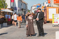 Couple dressed with period clothes walks through the street Royalty Free Stock Photo