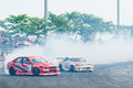 Couple drift competition makes a run during the D1 Grand Prix 2012 Thailand Stock Photo