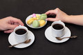 Couple drinking coffee with macaroon Stock Photography