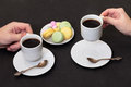 Couple drinking coffee with macaroon Stock Image