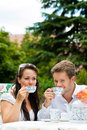 Couple drinking coffee in their garden Royalty Free Stock Photography