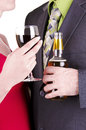 Couple drinking red wine and beer isolated on white Stock Photography