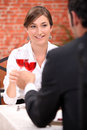 Couple drinking rose wine in a restaurant Stock Images