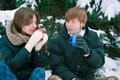 Couple drinking tea in winter the Royalty Free Stock Photography
