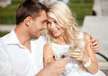 Couple drinking wine in cafe summer holidays and dating concept the city Royalty Free Stock Images