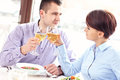 Couple drinking wine in a restaurant picture of young happy sitting and Royalty Free Stock Images