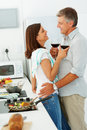Couple drinking wine together in the kitchen Royalty Free Stock Photo
