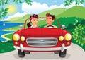 Couple driving along coastal road