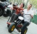 Couple driving double bike