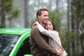 Couple driving in green car in love on travel happy drivers new rental vacation holidays road trip resting forest Royalty Free Stock Images