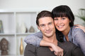 Couple at ease together young home Royalty Free Stock Images