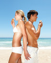 Couple eat an ice cream at the beach Royalty Free Stock Photos