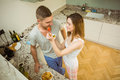 Couple eating fruit salad at breakfast home in the kitchen Stock Image