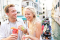 Couple eating fruit snack in venice lifestyle image of beautiful young healthy on on travel vacation italy Stock Photo