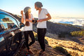 Couple eating having picnic near the car Royalty Free Stock Photo
