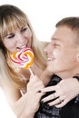 Couple eating lollypop shape of heart Stock Images