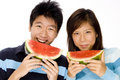 Couple Eating Melon Stock Photo