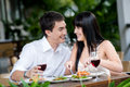 Couple Eating Outdoors Stock Photo