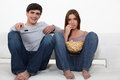 Couple eating popcorn Royalty Free Stock Photo