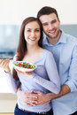 Couple eating salad and smiling Stock Photography