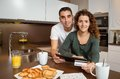 Couple with electronic tablet and credit card Royalty Free Stock Photo