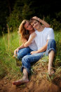 Couple embrace in high grass Stock Images