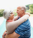 Couple embracing each other by a pool Stock Photography