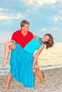 Couple embracing and resting on the beach Royalty Free Stock Photography