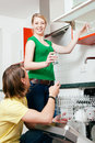 Couple emptying the dishwasher Royalty Free Stock Photo
