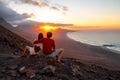 Couple enjoying beautiful sunset on Fuerteventura island