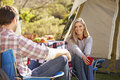 Couple enjoying camping holiday in countryside smiling Royalty Free Stock Photos