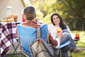 Couple enjoying camping holiday in countryside smiling Royalty Free Stock Image