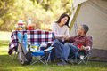 Couple enjoying camping holiday in countryside smiling Stock Photo